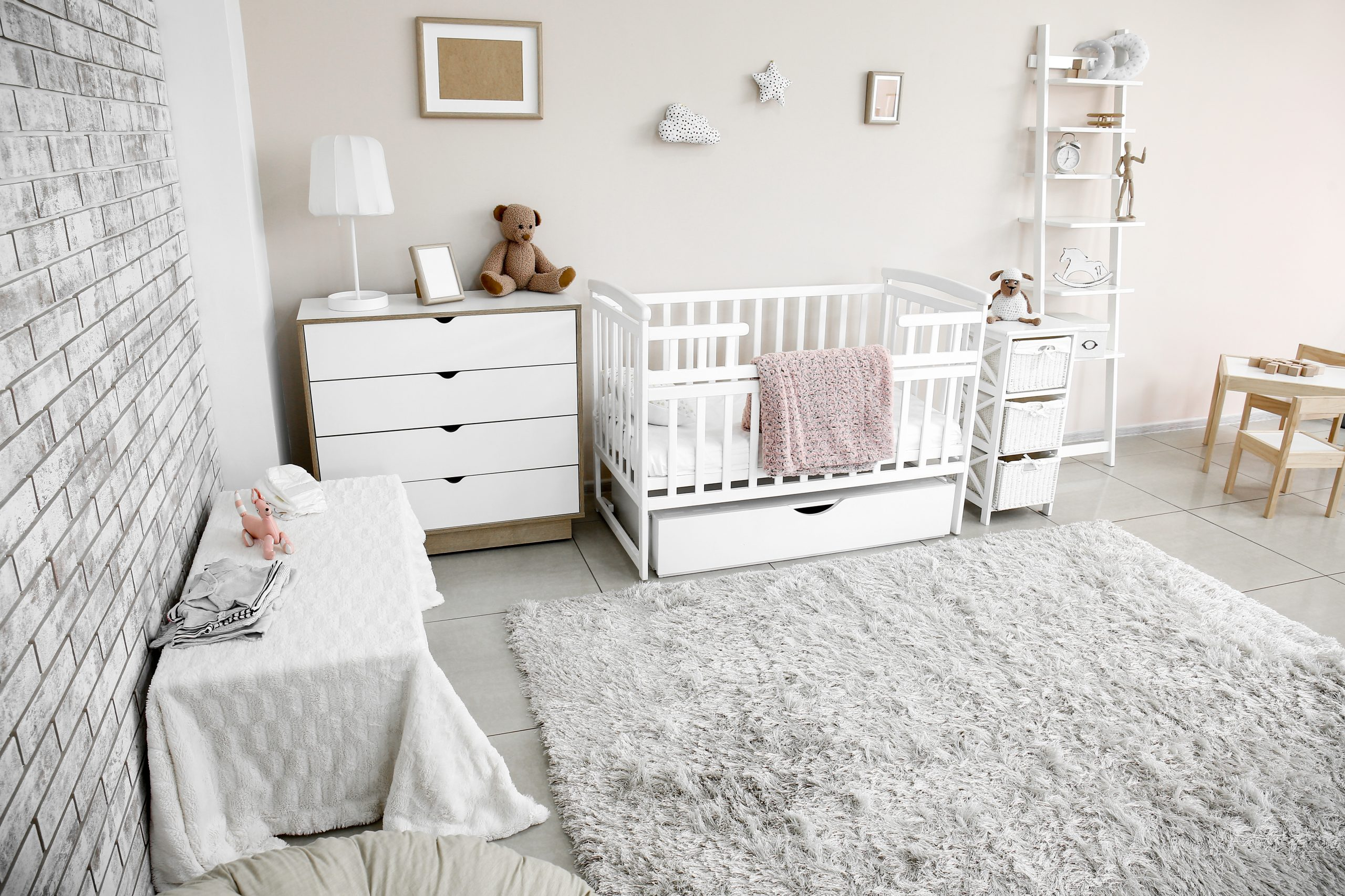 Interior of stylish children's room with baby bed