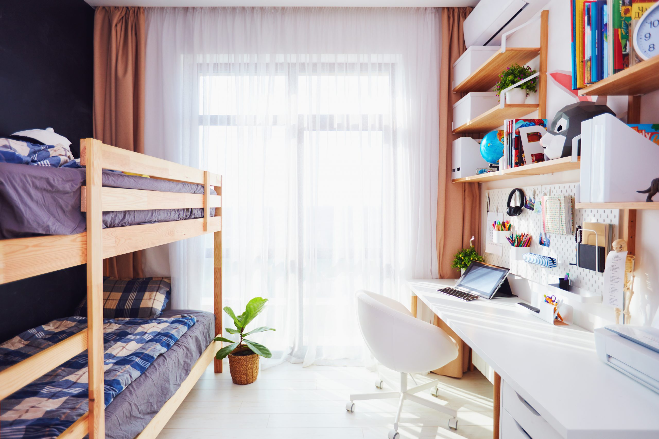 modern bright kids room with bunk bed and wall shelves